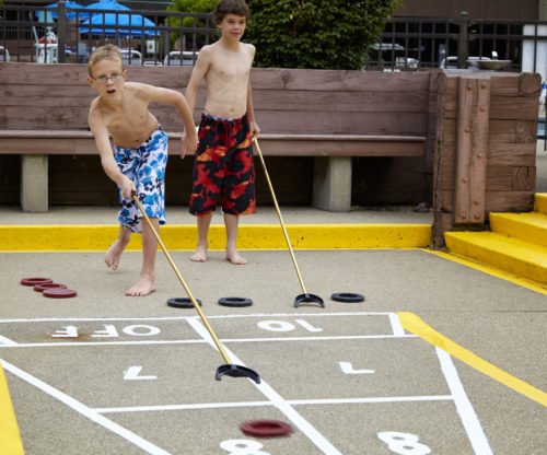 Boys Playing Shuffleboard